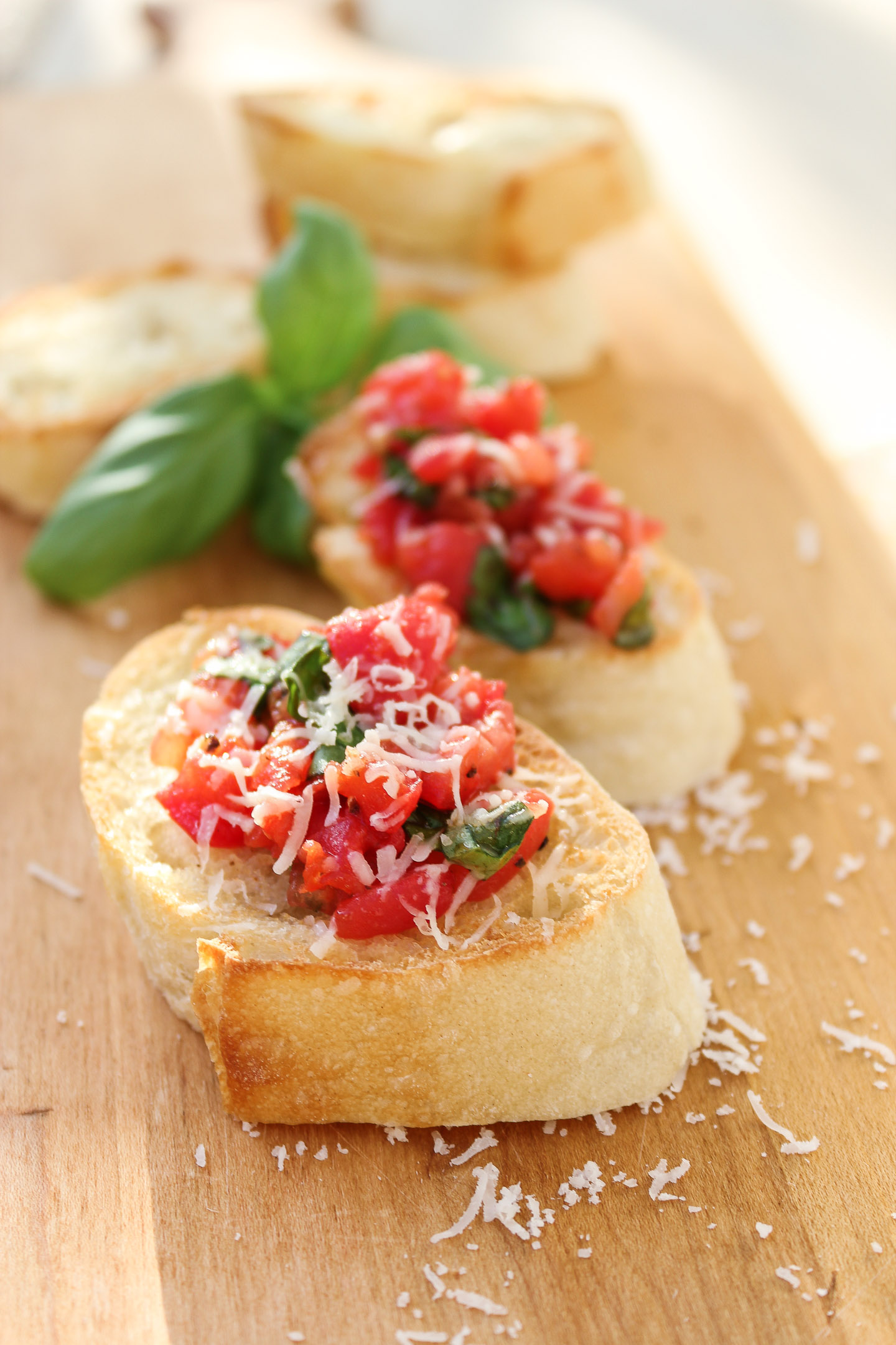 Sliced baguette topped with bruschetta mixture.
