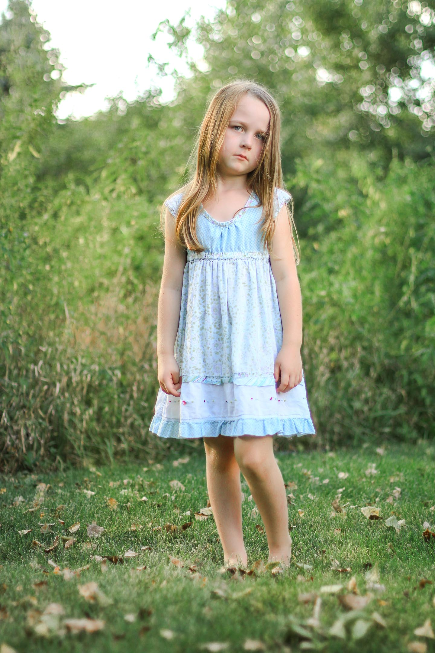 Little girl with a sad expression.